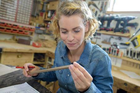 female carpenter works in a workshop