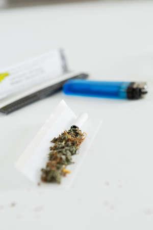 Open cannabis cigarette Stock Photo