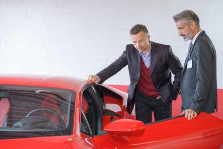luxury car dealer showing lamborghini to client