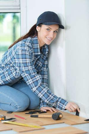 female floor installer inserting the wedges
