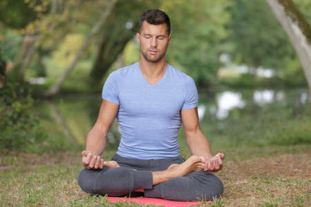 man yoga outdoors concept