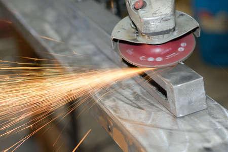 Closeup of angle grinder making sparks