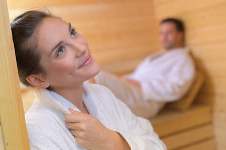 couple in sauna woman with faraway expression