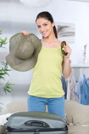 happy female finishing her travel preparations