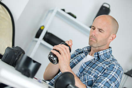 technician examining and repairing dslr camera