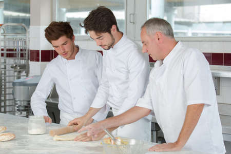 chef with apprentices at work