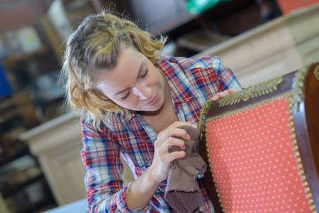 womanan working in upholstery workshop Standard-Bild
