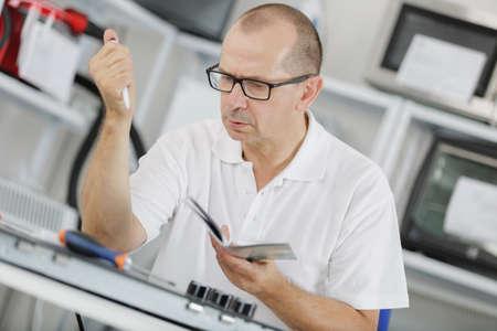 warranty technician in his workshop Stock Photo