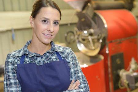 portrait of joyful young female worker near tank