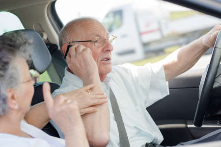 lady arguing with husband calling while driving