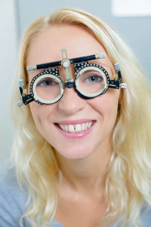 lady wearing opticians testing glasses