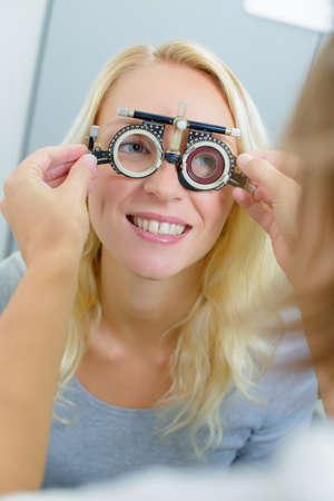 lady wearing opticians testing glasses