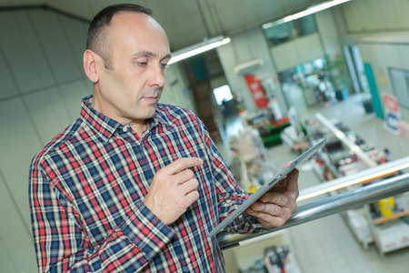 businessman with tablet analyzing stock at logistics port Banco de Imagens