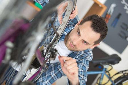 man mending the bikes gear