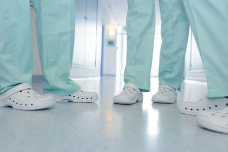 close up shoes of medical team in hospital corridor Foto de archivo