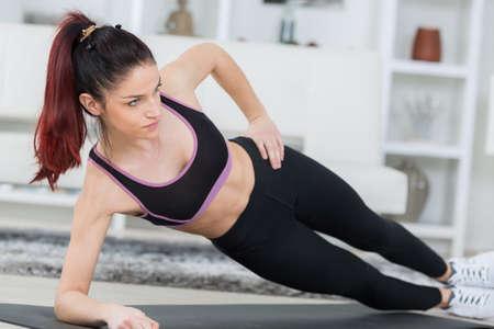 sport girl doing side plank Stock Photo