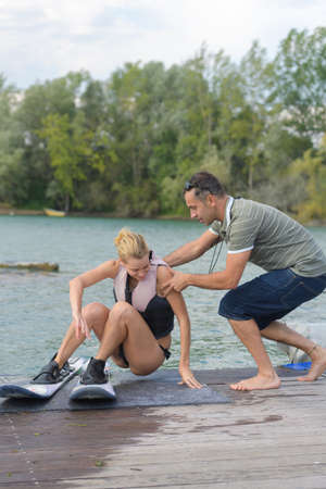 beautiful blond active with waterskiing coach
