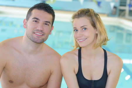 an image of a young couple at the pool