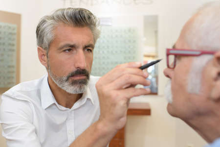 ophthalmologist at work in eye clinic