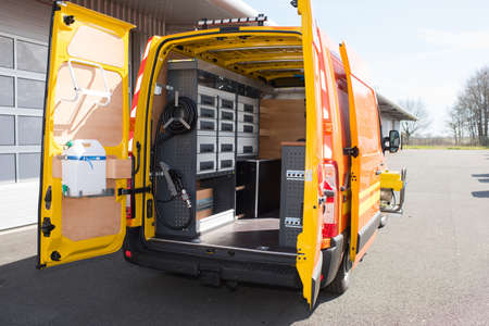 Rear view of mobile van workshop with doors open 写真素材