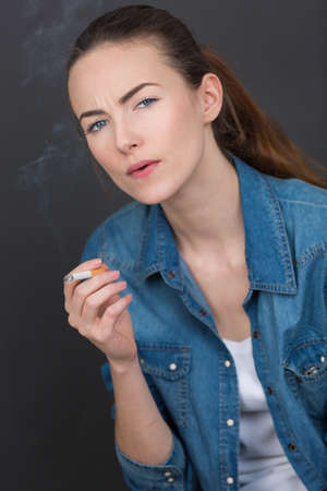 portrait of a girl with a cigarette Stock Photo