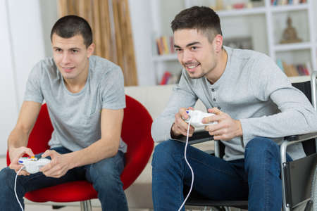 happy young brothers playing video games