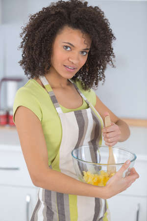 Woman creaming butter in mixing bowl
