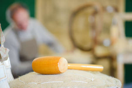closeup of an artisans wooden hammer Stock Photo