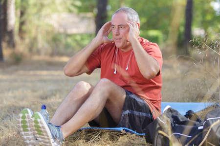 elderly man doing abs exercises