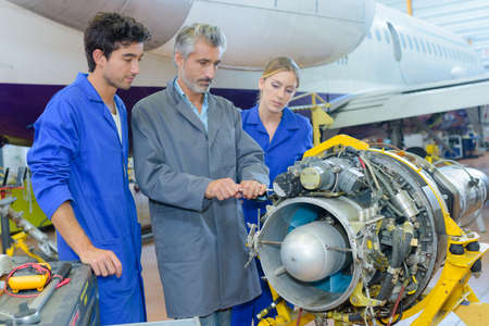 Students looking at aircraft turbine Stock Photo