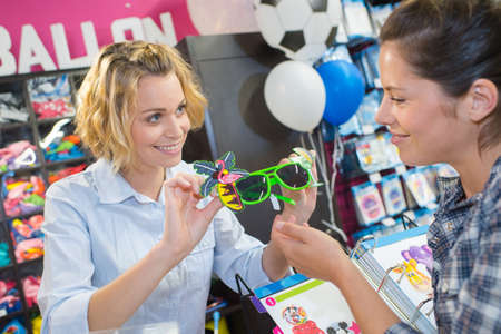 Woman looking at novelty sunglasses in store