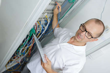 technician in server room at the data centre