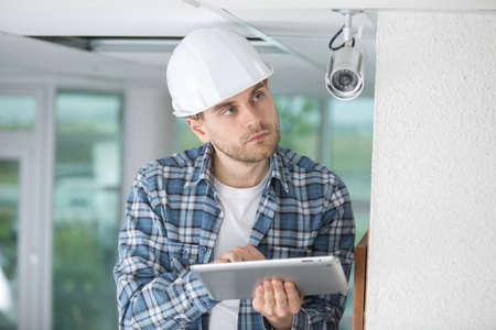 cctv installer working in building