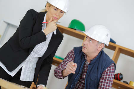 Project manager and contractor in discussion