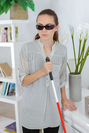 young blind woman with a cane