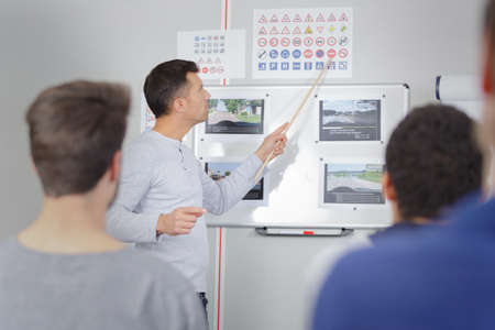 Instructor teaching at driving school