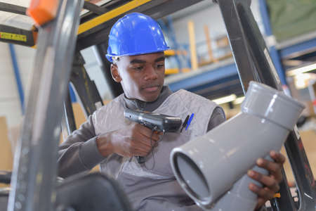 warehouseman with protective vest and scanner Stock Photo