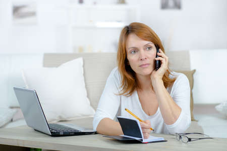 unemployed woman asking friend for money to pay out debts Stock Photo