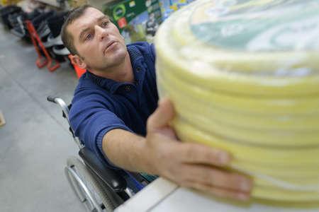 man in a wheelchair buying conduit nylon pipe