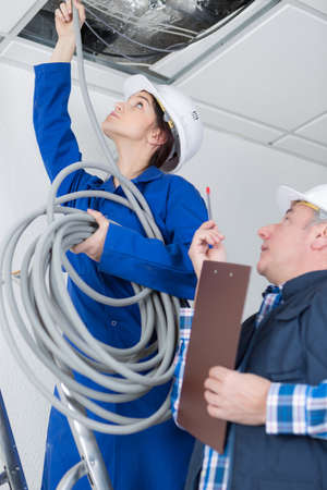 electrical team wiring a room Stock Photo