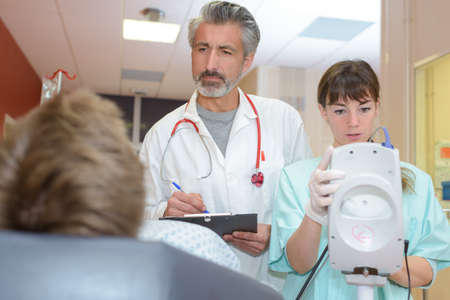 doctors telling patient the diagnosis Stock Photo