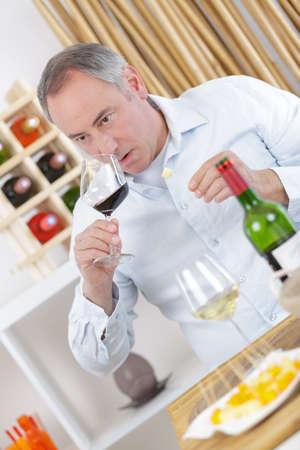 male sommelier appreciating drink
