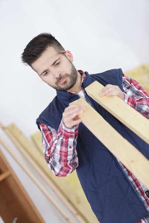 carpenter choosing wood Stock Photo