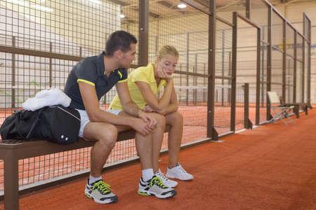 male tennis player calms distressed female partner