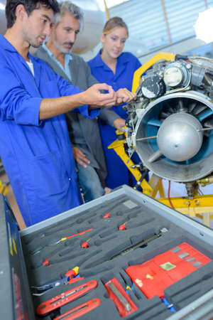 apprentices aeronautical engineers learning with their professor Stock Photo