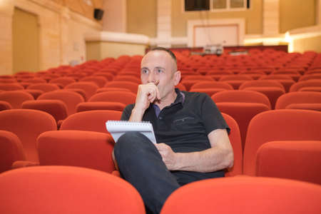 concentrated director in movie theater Stock Photo
