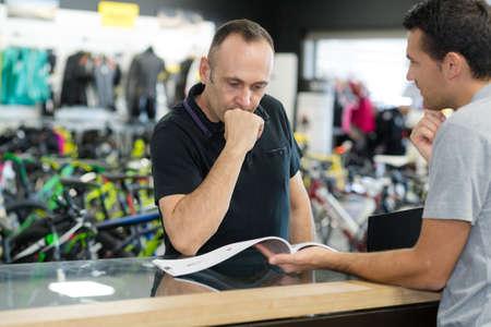 man sellertalking to customer in sport hypermarket