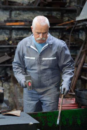 senior blacksmith Stock Photo