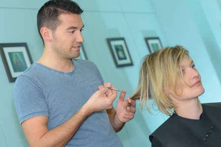 male hairdresser makes the cut for blonde girl
