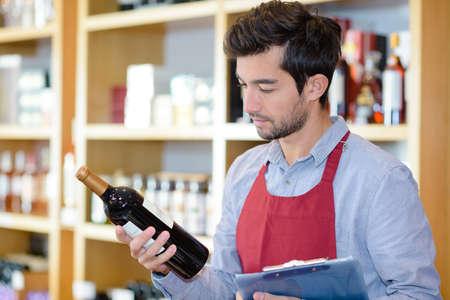 wine vendor reading the label